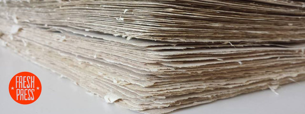 Photo of a stack of natural handmade papers