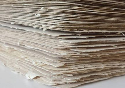 Closeup of a stack of handmade natural papers