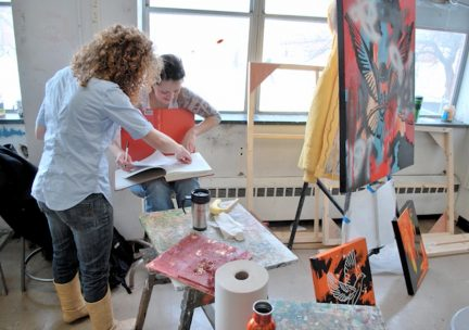 Students working in an Art & Design painting studio