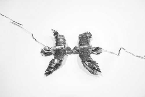 Detail of metalwork birds facing one another