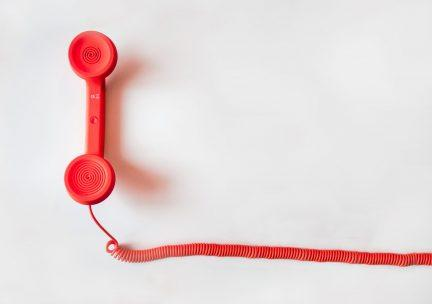 Red landline telephone handset
