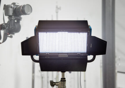 LED light on stand in front of camera