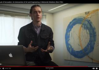 Sebastien Johnson talking with painting to side