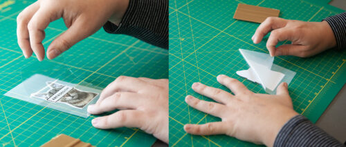 hands applying transfer tape to printed vinyl