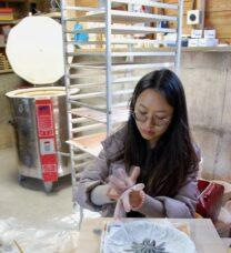 PhD student making a ceramic sculpture with their hands
