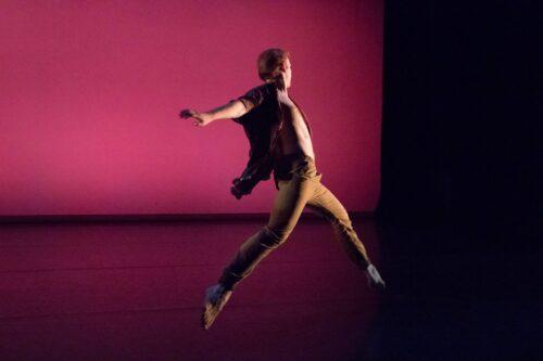 A dancer leaps through the air