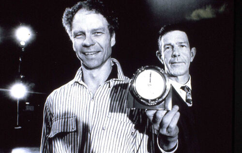 Merce Cunningham and John Cage smile in this black and white photo