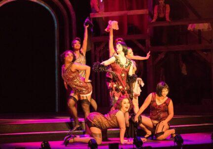 Dancers gather in a Cabaret