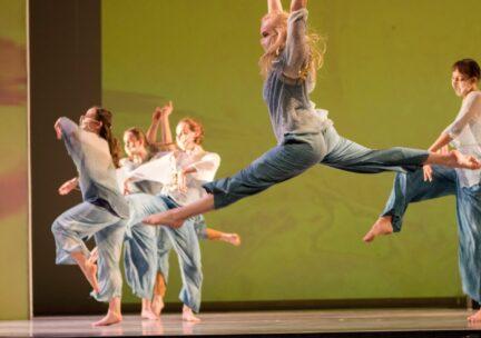 A dancer jumps through the air
