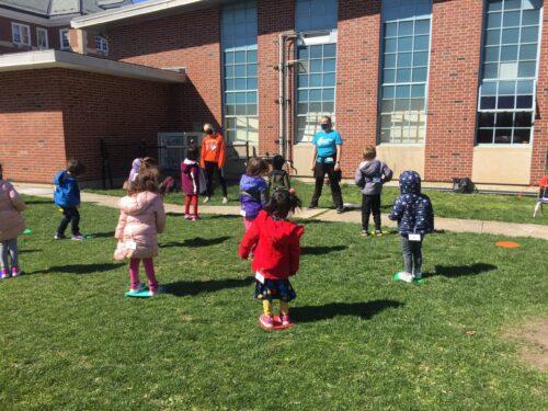 Children dance outside