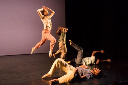 dancers jumping through the air