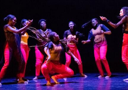 6 dancers surround one soloist