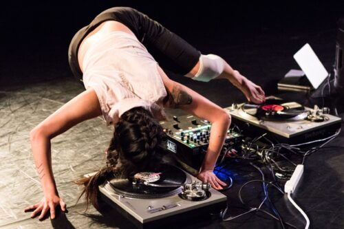 A dancer hovers over a turn table