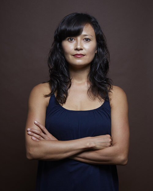 Headshot of Michelle with arms crossed