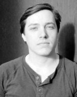Black and white headshot of Jacob