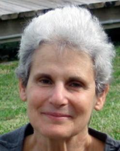 A headshot of Pat, smiling