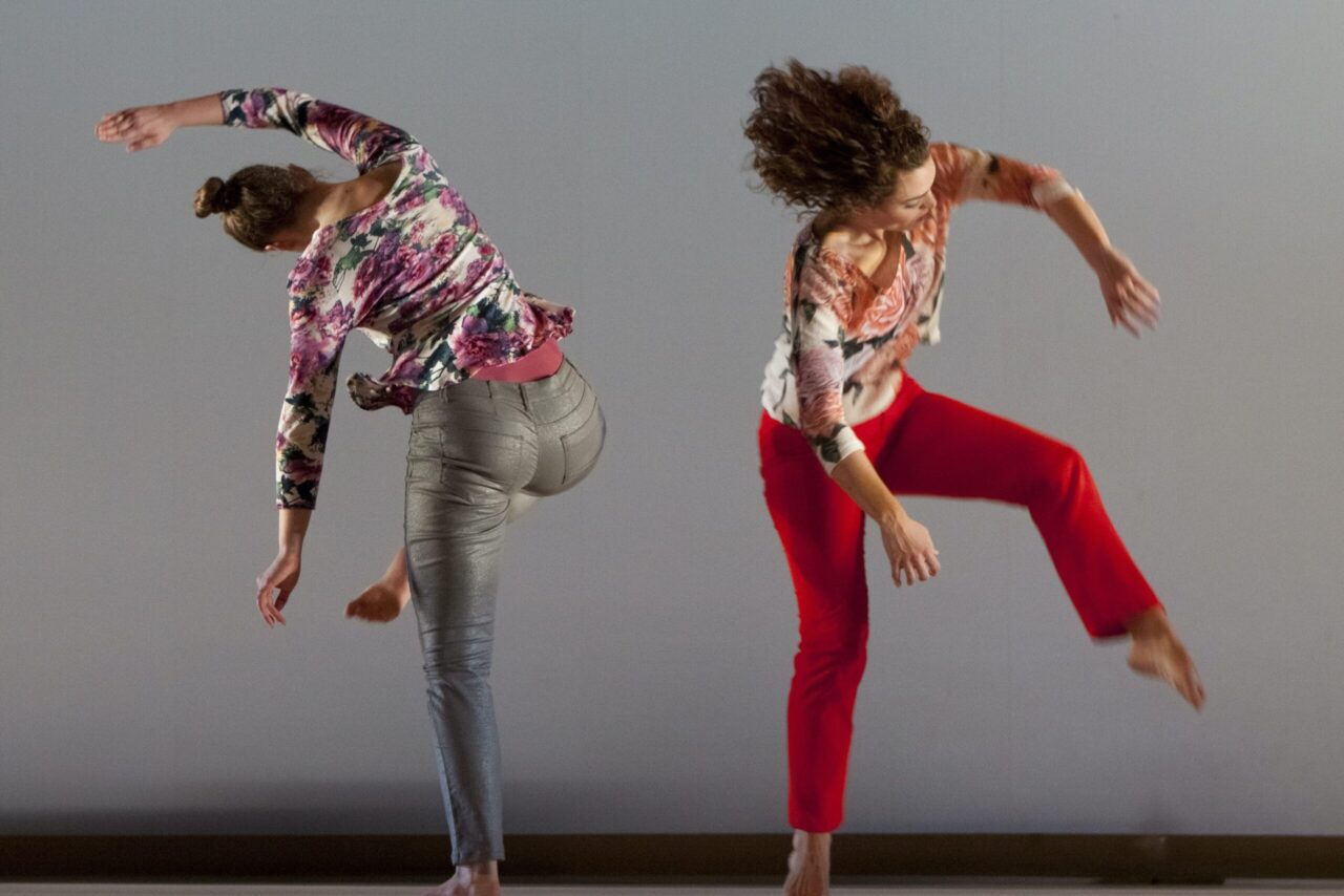 two dancers in motion away from each other