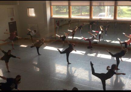 dancers balancing on one leg