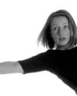 Black and White photo of Anna reaching backward with her right arm