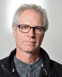 A headshot of John