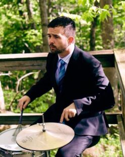 Drew playing the drums