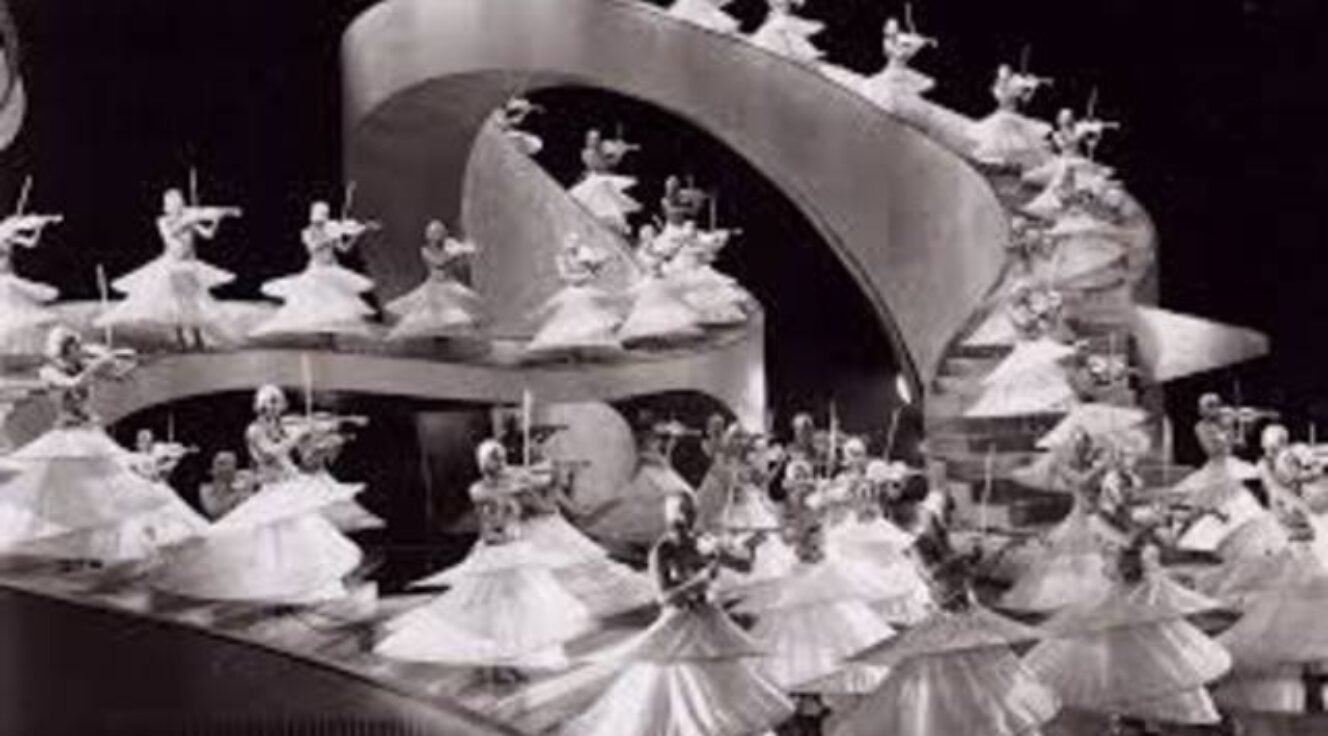 Black and white photo of many twirling dancers