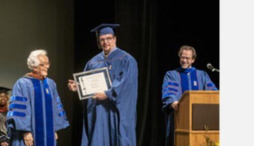 Shozo Sato and student with award