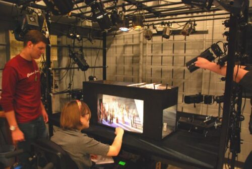 Two students examine a lighting model in the light laboratory