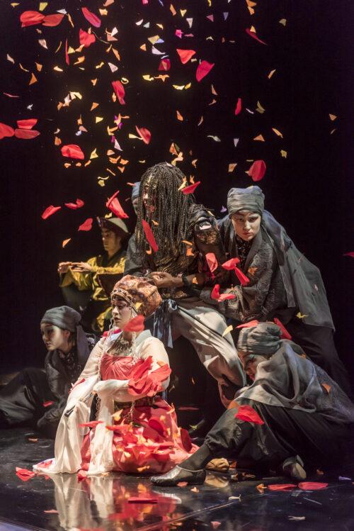 Petals fall on actors in theatre production