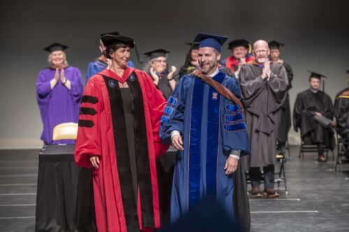 Student recieves doctorate at graduation