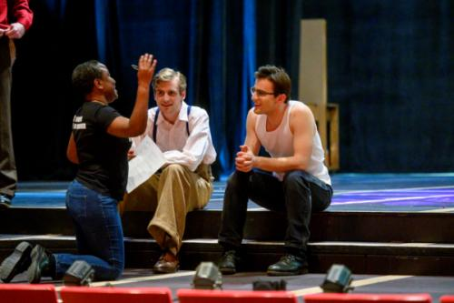 Director working with actors during rehearsal
