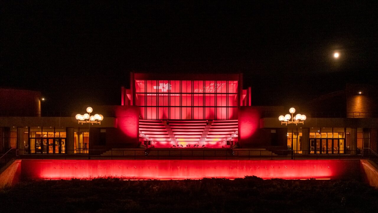 Exterior of Krannert Center for the Performing Arts lit in red